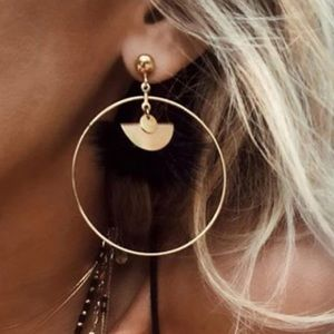 NEW gold tone circle and black feather earrings.